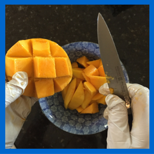 Cutting Mango With Gloves