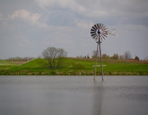 Windmill in the middle of a pond in Iowa