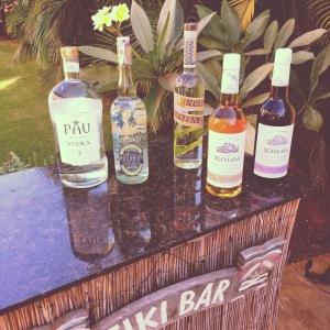 Local made spirits on a tiki bar.